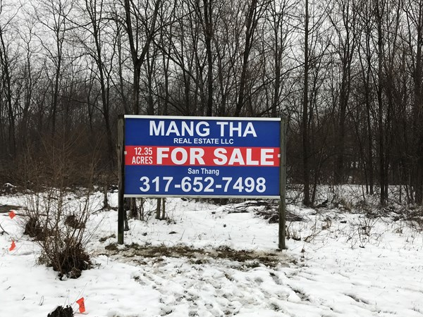Post and Panel Sign for Mang Tha Real Estate in Indianapolis IN